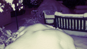 Our front yard this morning as of 6 AM--massive snow piles.