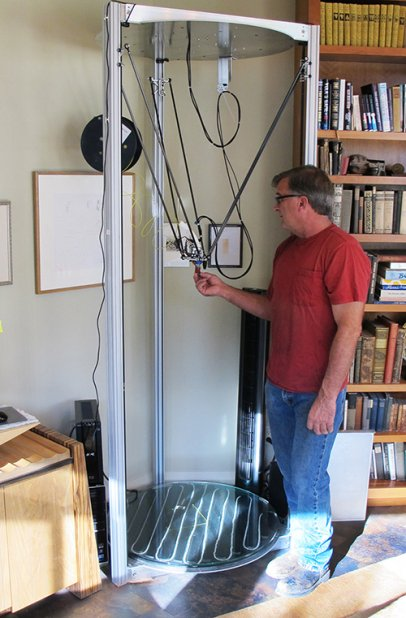 Artist Kevin Caron with his 8-foot-tall Cerberus 3D Gigante 3D printer