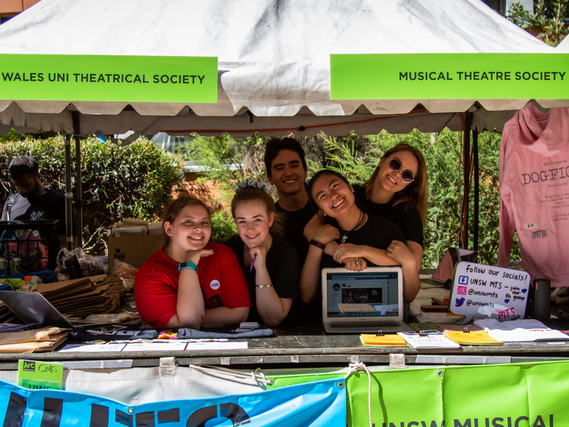 Students at a stall promoting clubs
