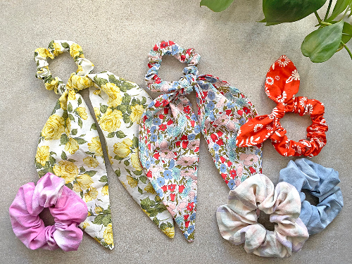 Hair accessories made in floral fabric, ice dye and japanese cotton including hair scarves and scrunchies.