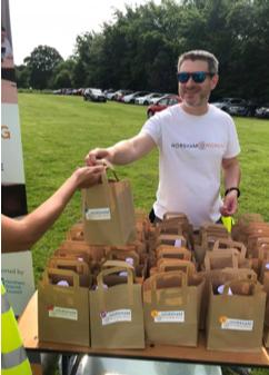 Matt giving out goody bags at the Horsham 10k race