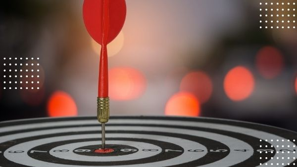 Red dart in bullseye of dartboard