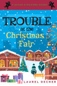 book cover of TROUBLE AT THE CHRISTMAS FAIR. Snow falling on Christmas market