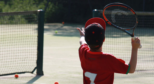 Young boy playing tennis at Pocklington Tennis Club
