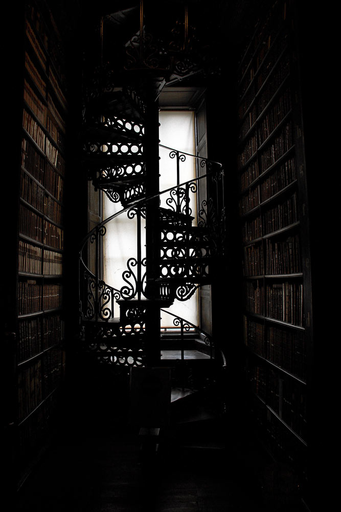 A spooky library staircase. Image courtesy of Pexels.com