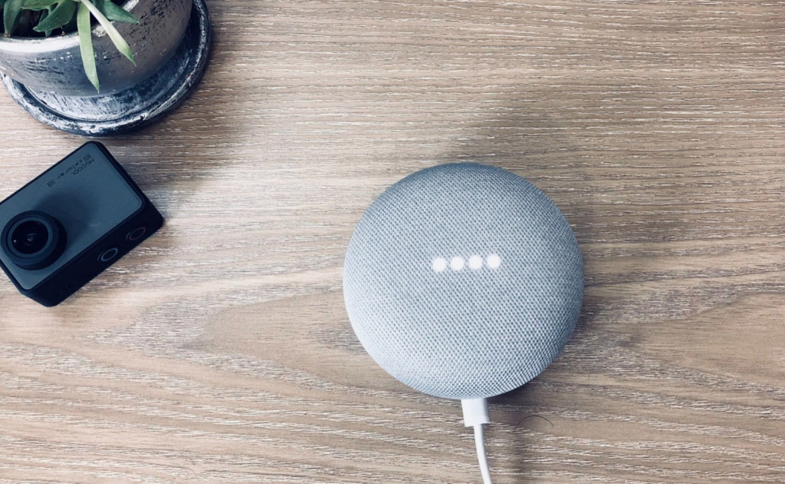 Image shows a speaker on a wooden surface
