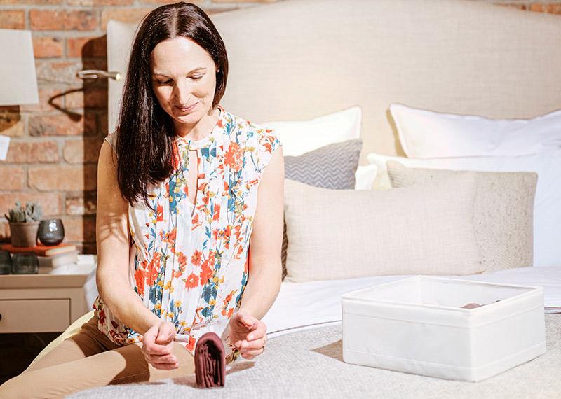 Jen folding Clothes