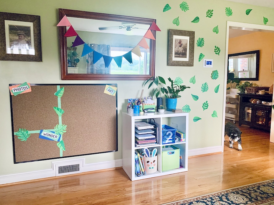 Living room with school decorations on wall