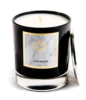 Oud Woods Deluxe Candle with silver lid to side