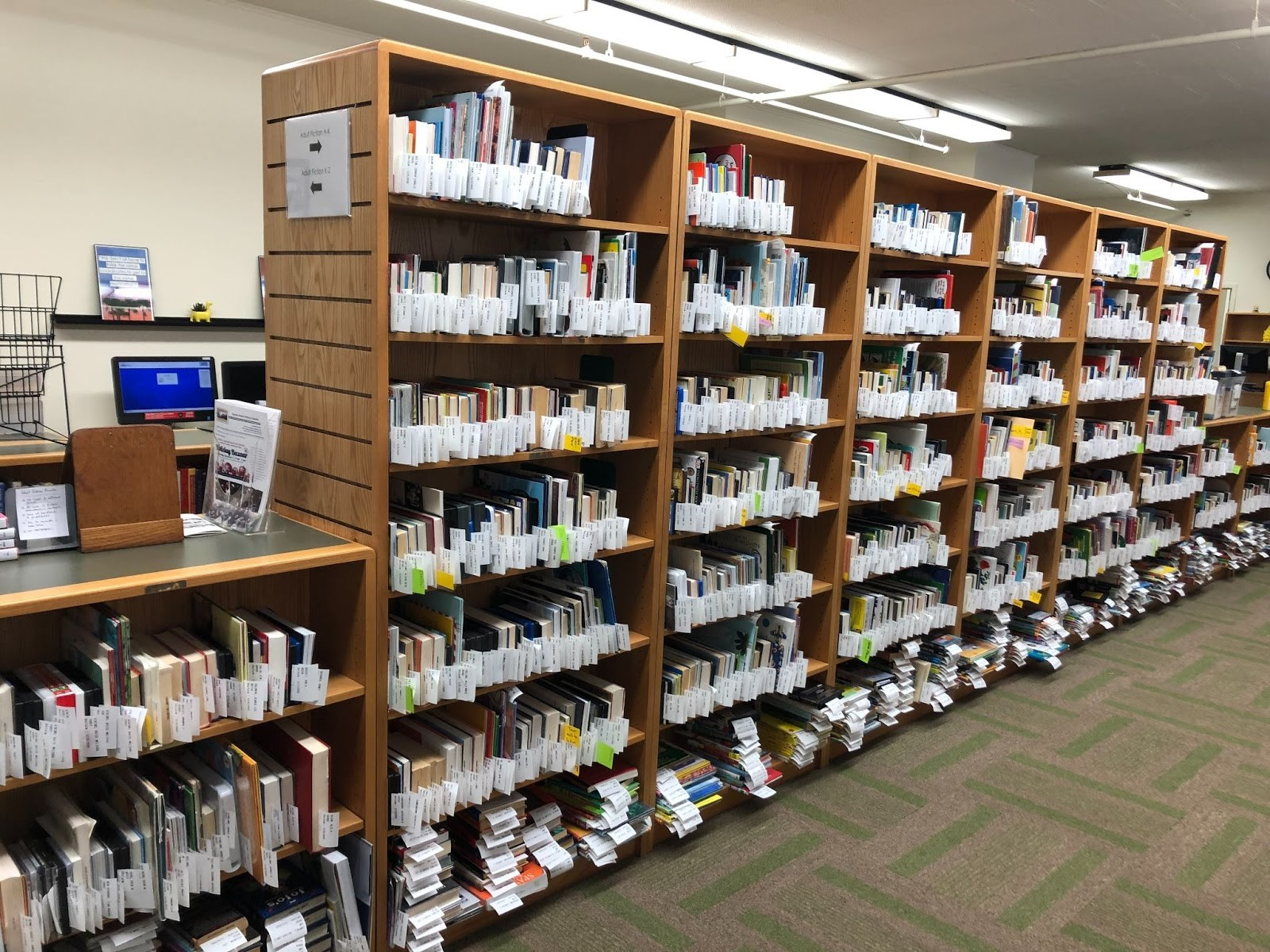 Shelves of holds at Garden Home Community Library