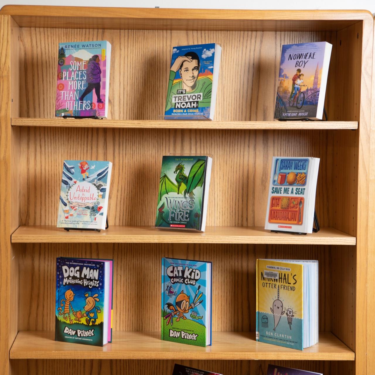 9 YA books displayed on bookshelf