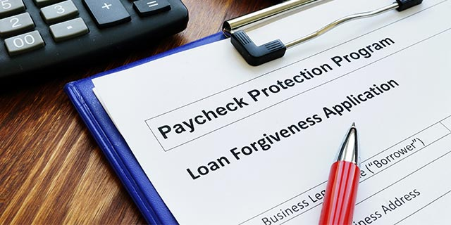 clipboard with form for Paycheck Protection Program Loan Forgiveness Application