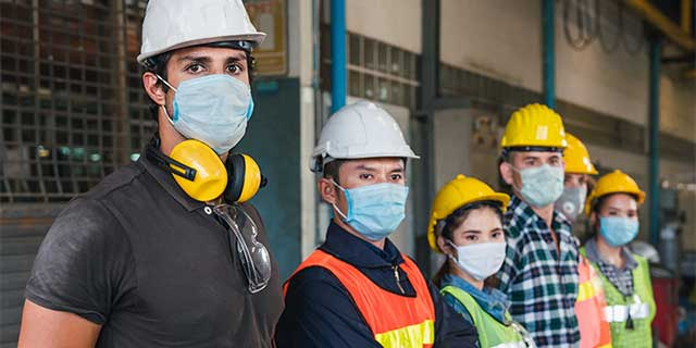 Work crew wearing masks and personal protective equipment