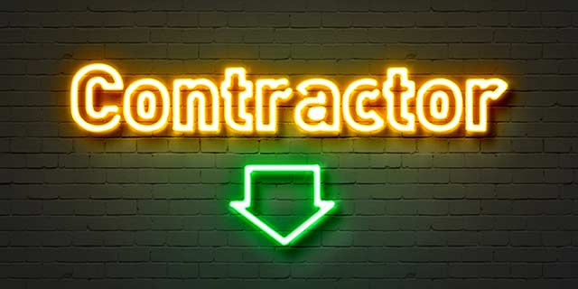 Neon lights spelling contractor with arrow pointing down
