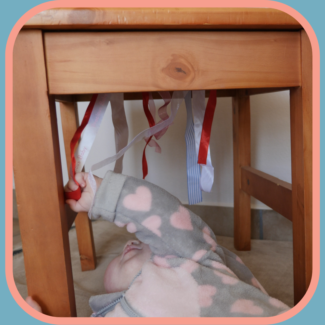 Pulling down ribbons under chair