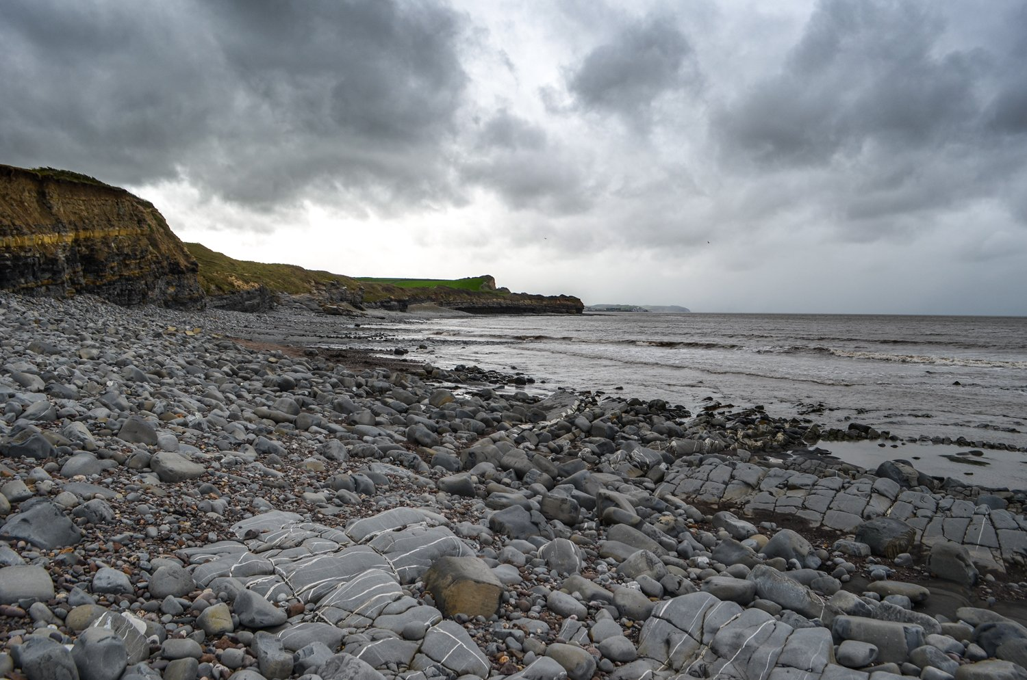 kilve beach in England, clouds and rocks