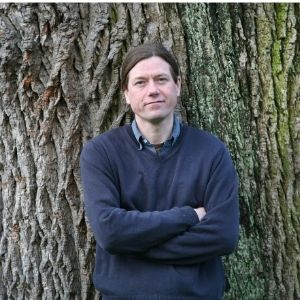 Writer James Canton standing in front of an oak tree.