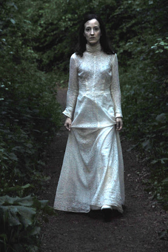 Woman in ghostly white dress Jillian Mcdonald