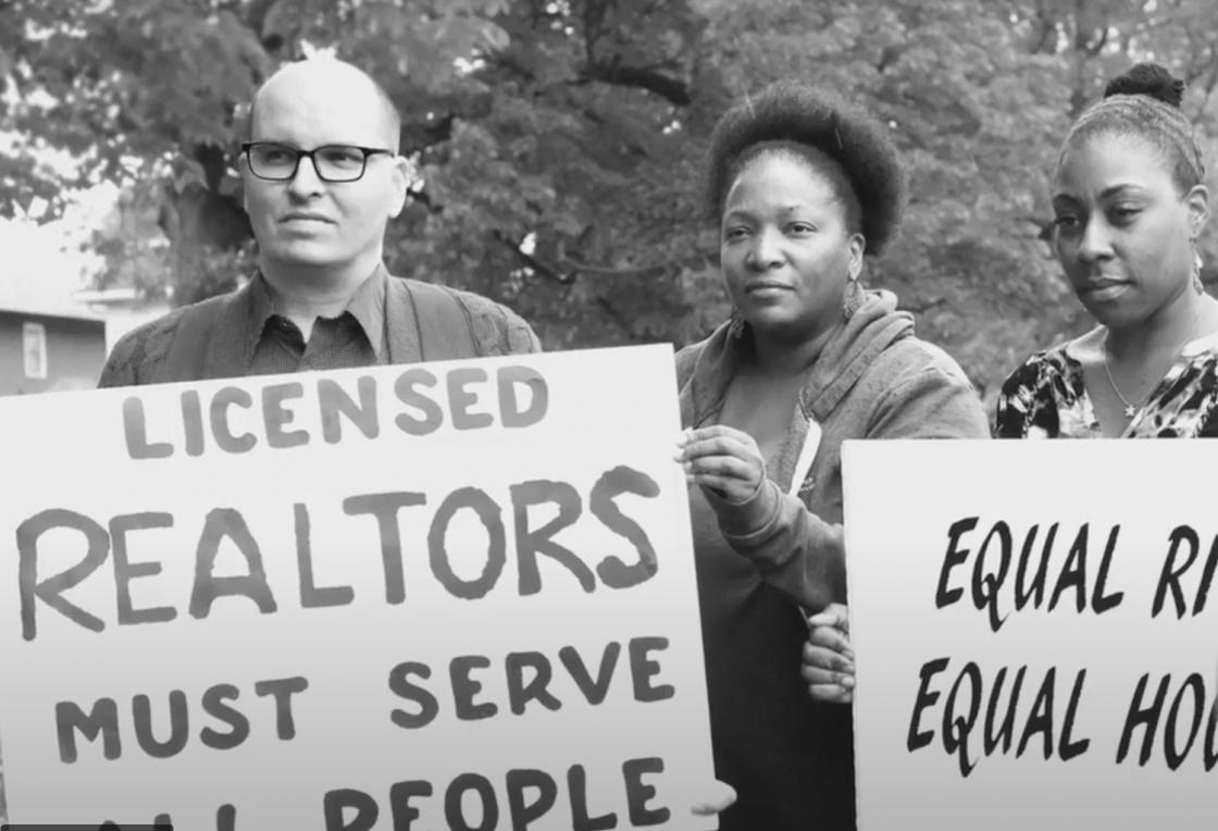 Fair housing activists in Oak Park against an oak tree