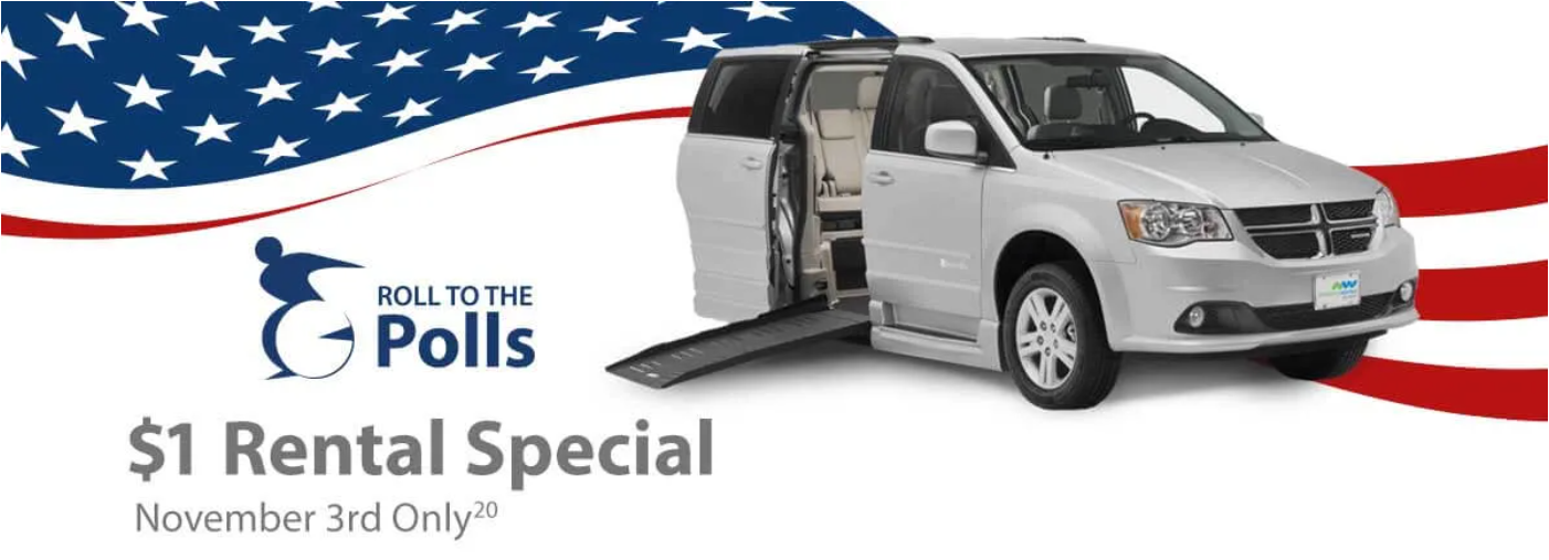 Silver van with the ramp out and a logo of a person using a wheelchair. In the background is an American flag