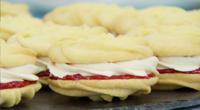Push the boat out with these melt-in-the-mouth biscuits filled with homemade jam and vanilla buttercream. This Viennese whirls recipe by Mary Berry is featured in Season 4, Episode 2.