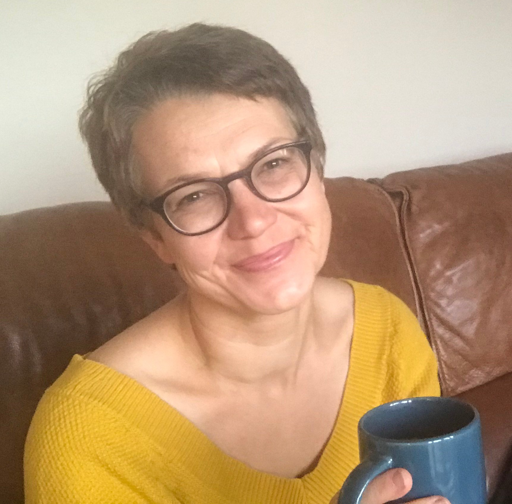 Karine with mug of tea