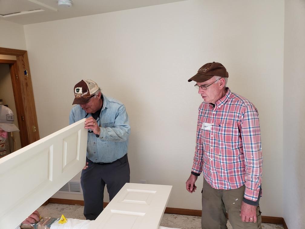 PHOTO: FUMC volunteers paint closet door at H4H renovation