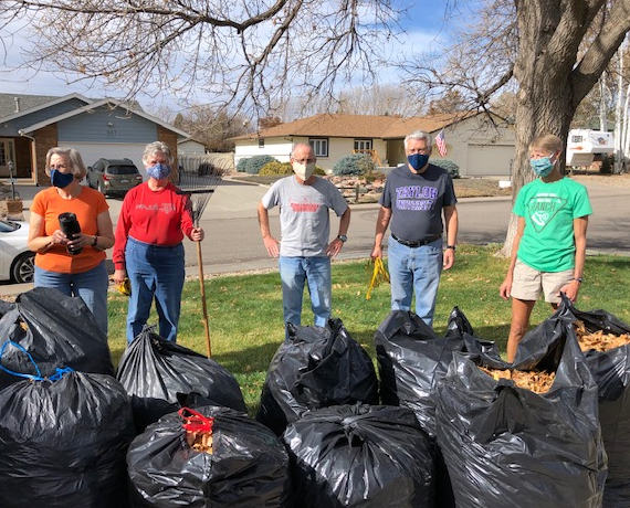 PHOTO: At Home crew after raking 21 bags of leaves
