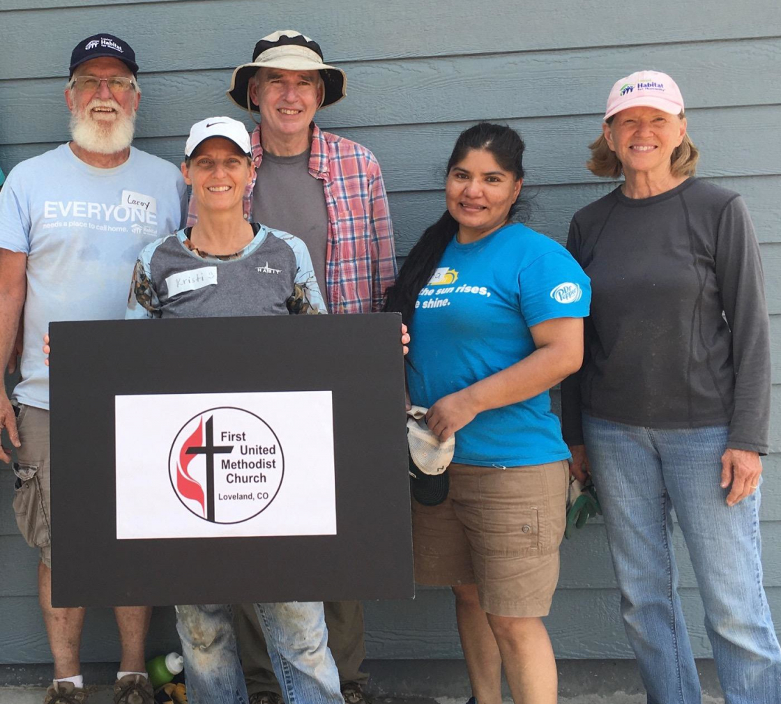 PHOTO: volunteering with future homeowner Irma