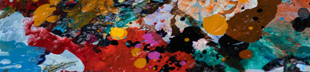 Cropped image of a colourful, paint-covered palette