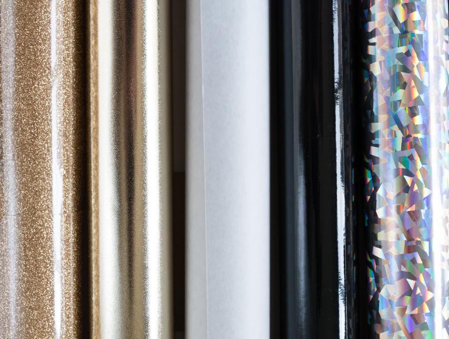rolls of adhesive vinyl