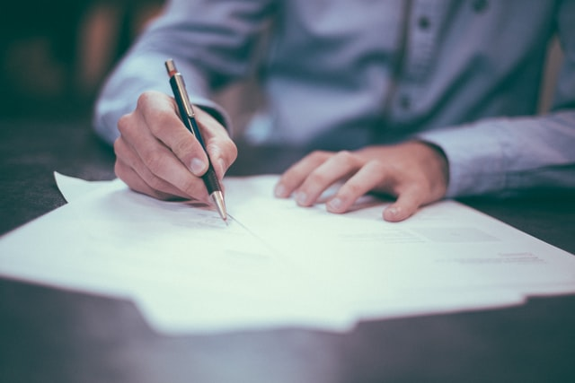 client-lawyer signing new company establishment