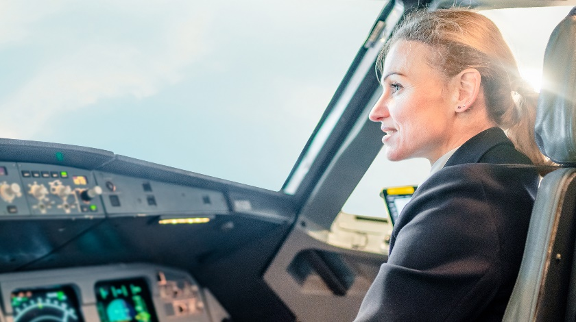 Breaking Stereotypes: Woman at the Controls of an Aircraft