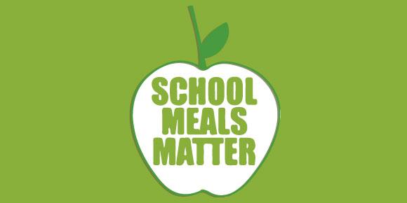 Apple with words 'School meals matter'