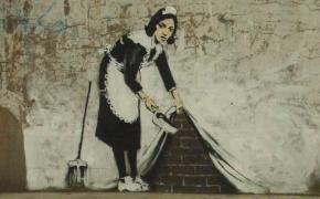 Woman emptying dustpan