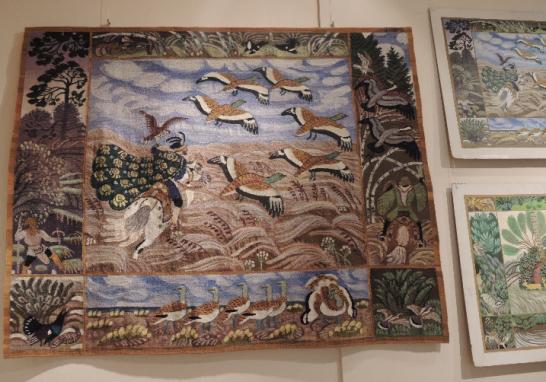 Tapestry of houbara-hawking scene