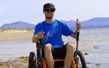 Mountain Trike wheelchair on a beach